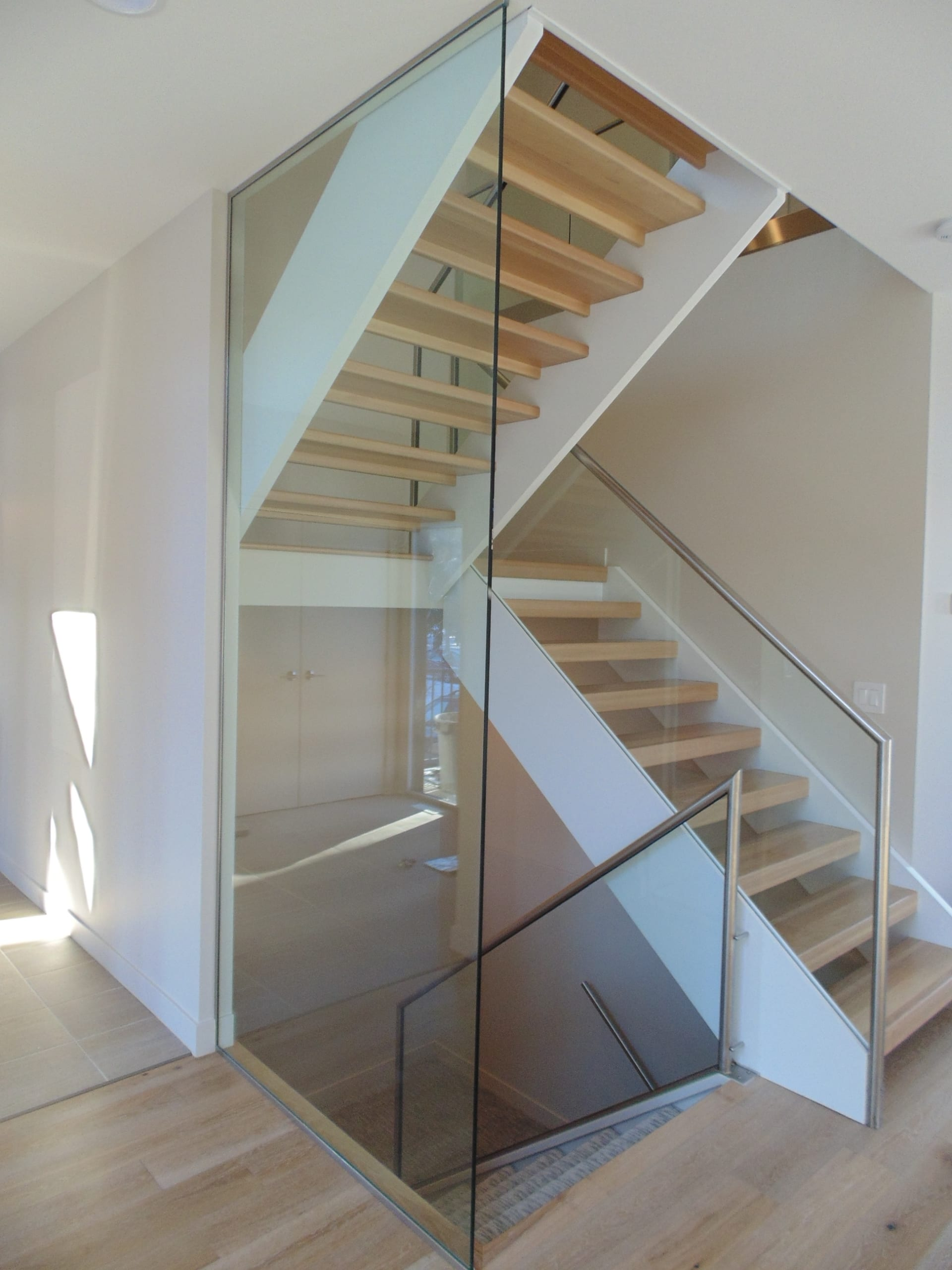 Open riser stairs in a custom home